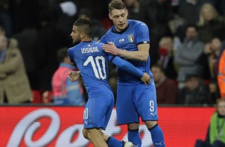 Italy's Lorenzo Insigne, left, celebrates with Andrea Belotti after scoring on a penalty during the international friendly soccer match between England and Italy at the Wembley Stadium in London, Tuesday, March 27, 2018. (AP Photo/Kirsty Wigglesworth)