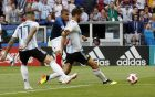 France's Kylian Mbappe, center, scores his side's third goal during the round of 16 match between France and Argentina, at the 2018 soccer World Cup at the Kazan Arena in Kazan, Russia, Saturday, June 30, 2018. (AP Photo/Frank Augstein)
