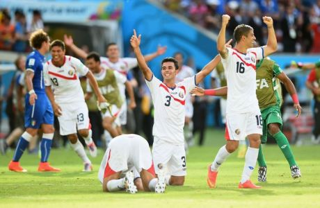 RECIFE, BRAZIL - JUNE 20: Giancarlo Gonzalez of Costa Rica celebrates with teammates after defeating Italy 1-0  on June 20, 2014 in Recife, Brazil.  (Photo by Laurence Griffiths/Getty Images)