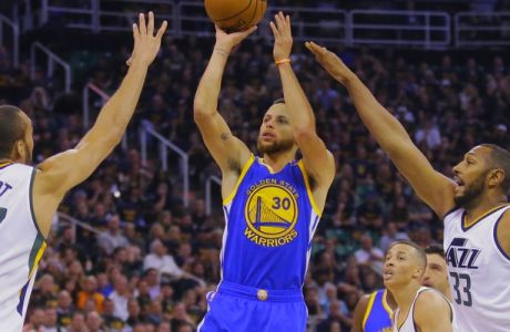Golden State Warriors guard Stephen Curry (30) shoots as Utah Jazz's Rudy Gobert (27) and Boris Diaw (33) defend in the first half during Game 4 of the NBA basketball second-round playoff series, Monday, May 8, 2017, in Salt Lake City. (AP Photo/Rick Bowmer)