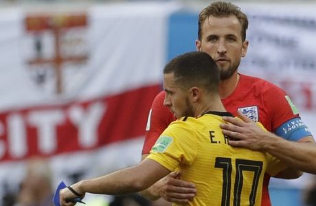 England's Harry Kane, face to camera, embraces Belgium's Eden Hazard following the third place match between England and Belgium at the 2018 soccer World Cup in the St. Petersburg Stadium in St. Petersburg, Russia, Saturday, July 14, 2018. (AP Photo/Petr David Josek)
