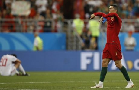 Portugal's Cristiano Ronaldo gestues to the fans after the end of he group B match between Iran and Portugal at the 2018 soccer World Cup at the Mordovia Arena in Saransk, Russia, Monday, June 25, 2018. The natch ended 1-1. (AP Photo/Francisco Seco)