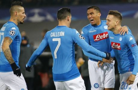 Napoli's Piotr Zielinski, right, celebrates scoring the opening goal with his teammates during a Champions League Group F soccer match between Feyenoord and Napoli at the Kuip stadium in Rotterdam, Netherlands, Wednesday, Dec. 6, 2017. (AP Photo/Peter Dejong)