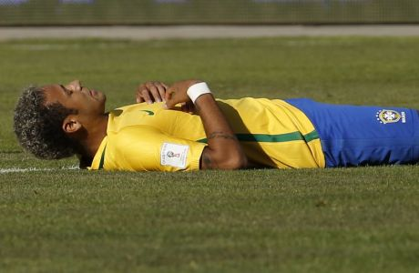 Brazil's Neymar lies on the pitch after missing a chance to score against Bolivia, during a World Cup qualifying soccer match in La Paz, Bolivia, Thursday, Oct. 5 2017. (AP Photo/Leo Correa)