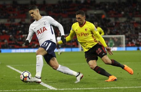 Tottenham's Erik Lamela, left, competes for the ball with Watford's Jose Holebas during the English Premier League soccer match between Tottenham Hotspur and Watford at Wembley stadium in London, Monday, April 30, 2018. (AP Photo/Kirsty Wigglesworth)