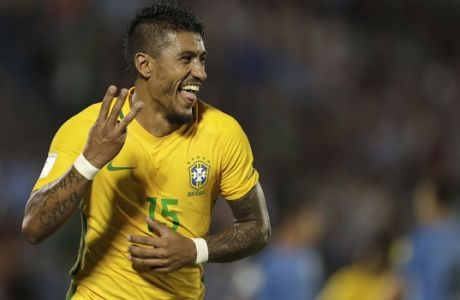 Brazil's Paulinho celebrates his hat trick during a 2018 World Cup qualifying soccer match against Uruguay in Montevideo, Uruguay, Thursday, March. 23, 2017. Brazil won the match 4-1. (AP Photo/Natacha Pisarenko)