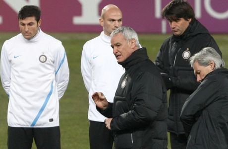 Inter Milan's Italian coach Claudio Ranieri , center, directs a training session, at the Velodrome stadium, in Marseille, southern France, Tuesday, Feb. 21, 2012. Inter Milan will face Marseille in a Champions League soccer match on Wednesday. (AP Photo/Claude Paris)