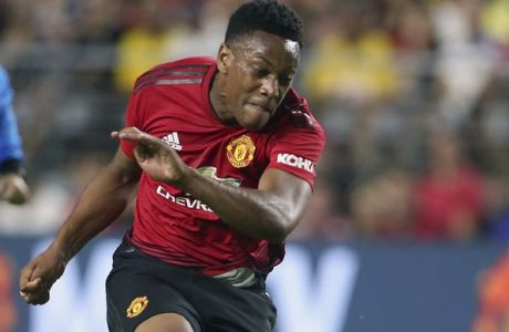 Manchester United forward Anthony Martial, center, kicks a shot on goal past Club America defender Emanuel Aguilera during the first half of a friendly soccer match at University of Phoenix Stadium, Thursday, July 19, 2018, in Glendale, Ariz. (AP Photo/Ralph Freso)