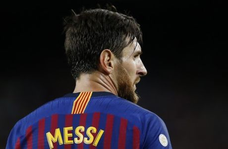 FC Barcelona's Lionel Messi looks on during the Spanish La Liga soccer match between FC Barcelona and Alaves at the Camp Nou stadium in Barcelona, Spain, Saturday, Aug. 18, 2018. (AP Photo/Manu Fernandez)