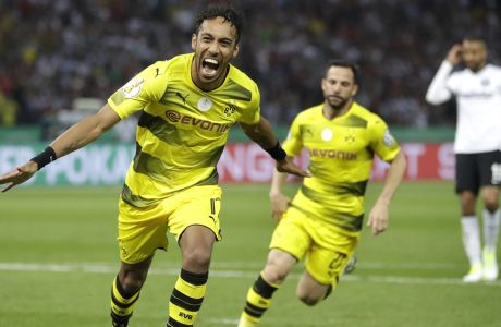 Dortmund's Pierre-Emerick Aubameyang, left, celebrates after scoring his side's 2nd goal during the German soccer cup final match between Borussia Dortmund and Eintracht Frankfurt in Berlin, Germany, Saturday, May 27, 2017. (AP Photo/Michael Sohn)