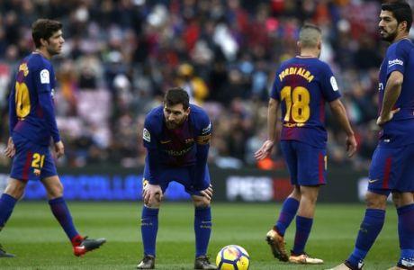 FC Barcelona's Lionel Messi, center, pauses during a Spanish La Liga soccer match between FC Barcelona and Celta Vigo at the Camp Nou stadium in Barcelona, Saturday, Dec. 2, 2017. (AP Photo/Manu Fernandez)