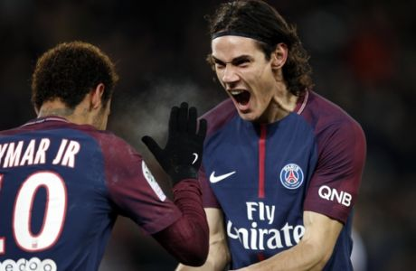 PSG's Neymar, left, and PSG's Edinson Cavani celebrate his goal during the French League One soccer match between Paris Saint Germain and Troyes, at the Parc des Princes stadium in Paris, France, Wednesday, Nov. 29, 2017. (AP Photo/Christophe Ena)