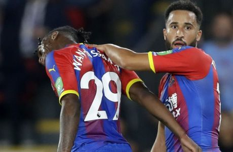 Crystal Palace's Aaron Wan-Bissaka, left, leaves the field after receiving a red card during the English Premier League soccer match between Crystal Palace and Liverpool at Selhurst Park stadium in London, Monday, Aug. 20, 2018. (AP Photo/Kirsty Wigglesworth)