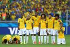 BELO HORIZONTE, BRAZIL - JUNE 28: (L-R) Thiago Silva, Luiz Gustavo, Ramires, Dani Alves, Jo, Marcelo, Hulk, Willian and Neymar of Brazil look on during a penalty shootout during the 2014 FIFA World Cup Brazil round of 16 match between Brazil and Chile at Estadio Mineirao on June 28, 2014 in Belo Horizonte, Brazil.  (Photo by Quinn Rooney/Getty Images)