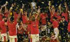 Moscow players celebrate as they win the Final Four Euroleague final basketball match between Anadolu Efes Istanbul and CSKA Moscow at the Fernando Buesa Arena in Vitoria, Spain, Sunday, May 19, 2019. (AP Photo/Alvaro Barrientos)