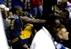FILE - This Nov. 19, 2004 file photo shows Indiana Pacers forward Ron Artest fighting with a fan during a a brawl at a game against the Detroit Pistons, in Auburn Hills, Mich. Violence is part of the game in many sports. But when athletes cross the line it can attract the attention of authorities _ sometimes from within their sport and in other cases from criminal prosecutors. The punishment of four members of the New Orleans Saints for participating a cash-for-hits bounty system targeting opponents is the latest example but not the only one. (AP Photo/Duane Burleson, File)