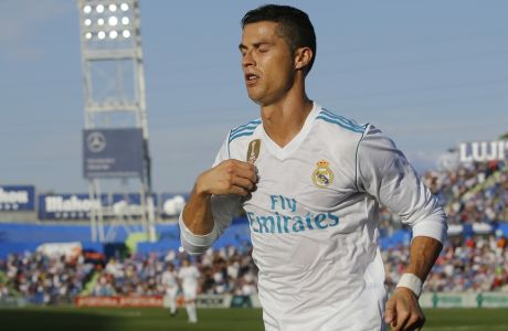Real Madrid's Cristiano Ronaldo celebrates after scoring the winning goal during a Spanish La Liga soccer match between Getafe and Real Madrid at the Coliseum Alfonso Perez in Getafe, Spain, Saturday, Oct. 14, 2017. (AP Photo/Paul White)