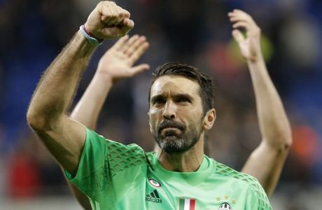 Juventus goalkeeper Gianluigi Buffon clenches his fist after the Champions League Group H soccer match against Lyon, Tuesday Oct. 18, 2016, in Lyon, central France. Juventus won 1-0. (AP Photo/Laurent Cipriani)