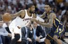 Cleveland Cavaliers' Kyrie Irving, left, drives past Indiana Pacers' Jeff Teague in the second half in Game 2 of a first-round NBA basketball playoff series, Monday, April 17, 2017, in Cleveland. The Cavaliers won 117-111. (AP Photo/Tony Dejak)