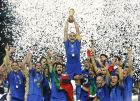 ** FILE ** Italy's Fabio Cannavaro lifts the trophy after defeating France 5-3 in a penalty shootout in the final of the soccer World Cup between Italy and France, in the Olympic Stadium in Berlin, in this Sunday, July 9, 2006 file photo. World Cup champion Italy ended Brazil's 55-month stay at the top of FIFA's world soccer rankings, taking the top spot for the first time since 1993. Although Italy's last match was in November, Brazil slipped to second place because of a 2-0 loss to eighth-ranked Portugal last week. In the list released Wednesday Feb 14, 2007  by FIFA, Italy had 1,562 points, 22 more than Brazil, and 27 more than third-place Argentina. (AP Photo/Luca Bruno)