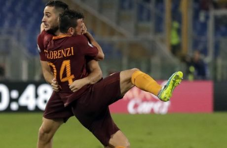 Romas Kostas Manolas, left, celebrates with teammate Alessandro Florenzi after scoring, during a Serie A soccer match between Roma and Inter Milan, at Rome's Olympic Stadium, Sunday, Oct. 2, 2016. (AP Photo/Andrew Medichini)