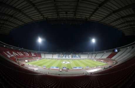 The empty Rajko Mitic stadium is seen before the start the Champions League qualifying play-off first leg soccer match between Red Star and Salzburg, in Belgrade, Serbia, Tuesday, Aug. 21, 2018. The match is played at the empty stadium because of earlier fan trouble. (AP Photo/Darko Vojinovic)