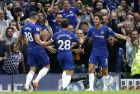 Chelsea's Marcos Alonso, right, celebrates after scoring his side's third goal during the English Premier League soccer match between Chelsea and Arsenal at Stamford bridge stadium in London, Saturday, Aug. 18, 2018. (AP Photo/Tim Ireland)