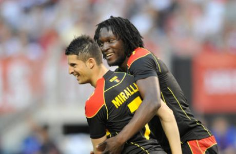 May 29, 2013; Cleveland, OH, USA; Belgium forward Kevin Mirallas (7) celebrates his goal in the first half with forward Romelu Lukaku (9) against the United States at FirstEnergy Stadium. Belgium won 4-2. Mandatory Credit: David Richard-USA TODAY Sports