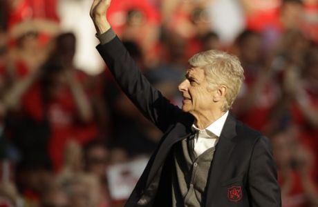 Arsenal's French manager Arsene Wenger waves to spectators during his lap of honor at the Emirates Stadium in London, Sunday, May 6, 2018. The match is Arsenal manager Arsene Wenger's last home game in charge after announcing in April he will stand down as Arsenal coach at the end of the season after nearly 22 years at the helm. (AP Photo/Matt Dunham)