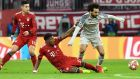 Liverpool forward Mohamed Salah, right, duels for the ball with Bayern defender David Alaba during the Champions League round of 16 second leg soccer match between Bayern Munich and Liverpool at the Allianz Arena, in Munich, Germany, Wednesday, March 13, 2019. (AP Photo/Kerstin Joensson)