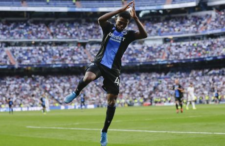 Brugge's Emmanuel Dennis celebrates after scoring his side's second goal during the Champions League group A soccer match between Real Madrid and Club Brugge, at the Santiago Bernabeu stadium in Madrid, Tuesday, Oct.1, 2019. (AP Photo/Manu Fernandez)