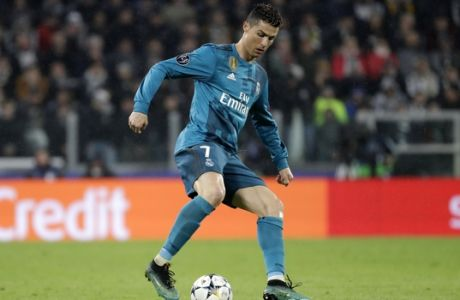 Real Madrid's Cristiano Ronaldo controls the ball during the Champions League, round of 8, first-leg soccer match between Juventus and Real Madrid at the Allianz stadium in Turin, Italy, Tuesday, April 3, 2018. (AP Photo/Luca Bruno)