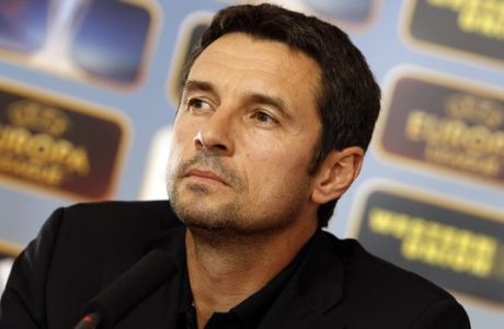 Lyon's soccer coach Remi Garde looks on during a press conference in Lyon, central France, Wednesday, Sept. 19, 2012. Lyon will face Sparta Prague in an Europa League soccer match on Thursday. (AP Photo/Laurent Cipriani)