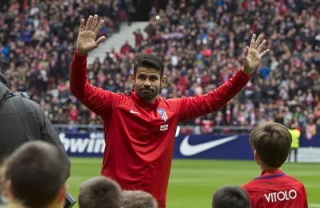 Diego Costa waves to fans during his official presentation for Atletico Madrid at the Wanda Metropolitano stadium in Madrid, Spain, Sunday, Dec. 31, 2017. Costa was signed from Chelsea earlier in 2017 but was not eligible to play until 2018. (AP Photo/Paul White)