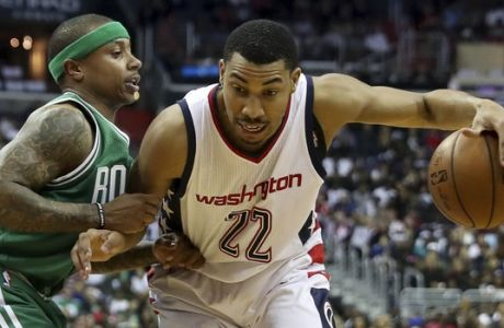 Boston Celtics guard Isaiah Thomas (4) guards against Washington Wizards forward Otto Porter Jr. (22) during the first half in Game 3 of a second-round NBA playoff series basketball game, Thursday, May 4, 2017, in Washington. (AP Photo/Andrew Harnik)