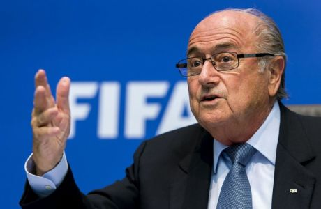 """FIFA President Sepp Blatter speaks during a press conference on October 4, 2013 at the FIFA headquarters in Zurich. FIFA said they could not get involved in labour issues in any country, amid calls for action after claims that dozens of migrant workers had died on construction projects linked to the 2022 World Cup in Qatar. Blatter, however said that the federation could not turn a blind eye to the reports, which also alleged that thousands of other workers endured conditions akin to """"modern-day slavery"""" in Qatar. AFP PHOTO / FABRICE COFFRINIFABRICE COFFRINI/AFP/Getty Images"""