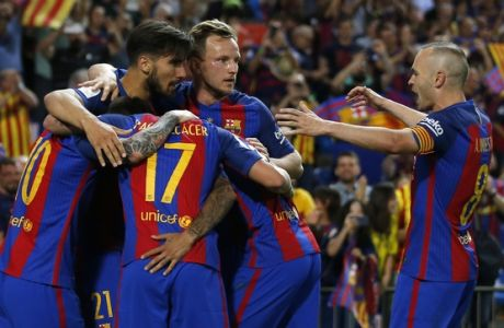Barcelona's Neymar, second left, celebrates with team mates after scoring a goal during the Copa del Rey final soccer match between Barcelona and Alaves at the Vicente Calderon stadium in Madrid, Spain, Saturday May 27, 2017. (AP Photo/Daniel Ochoa de Olza)