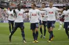 Tottenham's Christian Eriksen, centre, celebrates after scoring a goal during the English Premier League soccer match between West Ham United and Tottenham Hotspur at the London Stadium in London, Saturday Sept. 23, 2017. (AP Photo/Tim Ireland)