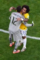 BELO HORIZONTE, BRAZIL - JUNE 28:  Goalkeeper Julio Cesar and Marcelo of Brazil celebrate after defeating Chile in a penalty shootout during the 2014 FIFA World Cup Brazil round of 16 match between Brazil and Chile at Estadio Mineirao on June 28, 2014 in Belo Horizonte, Brazil.  (Photo by Pool/Getty Images)