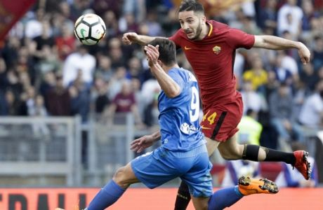 Fiorentina's Giovanni Simeone, left, and Roma's Kostas Manolas fight for the ball during a Serie A soccer match between Roma and Fiorentina, at Rome's Olympic Stadium, Saturday, April 7, 2018. (AP Photo/Gregorio Borgia)