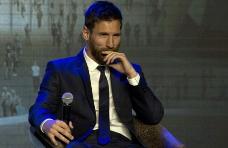 Barcelona's Lionel Messi , reacts to a fan's question on when he will shave his beard during an event to launch the establishment of Messi Experience Park in Beijing, China, Thursday, June 1, 2017. The park to be completed within 2 years in eastern China will be based on football culture and promote the sports amongst China's youths. (AP Photo/Ng Han Guan)