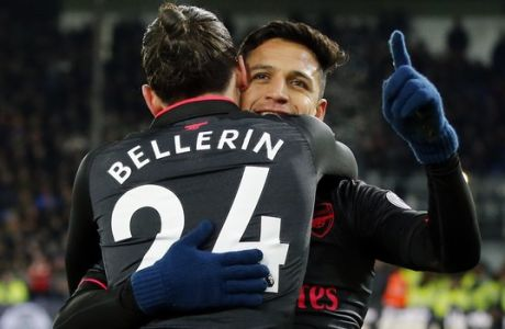 Arsenal's Alexis Sanchez, right, celebrates with teammate Hector Bellerin after scoring his side's third goal of the game during their English Premier League soccer match between Crystal Palace and Arsenal at Selhurst Park stadium in London, Thursday, Dec. 28, 2017. (AP Photo/Alastair Grant)