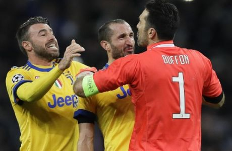 From left, Juventus' Andrea Barzagli, Giorgio Chiellini and Gianluigi Buffon celebrate their side's 2-1 win, at the end of the the Champions League, round of 16, second-leg soccer match between Juventus and Tottenham Hotspur, at the Wembley Stadium in London, Wednesday, March 7, 2018. (AP Photo/Kirsty Wigglesworth)