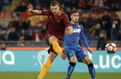Roma's Edin Dzeko scores a goal during a Serie A soccer match between Roma and Sassuolo, at the Olympic stadium in Rome, Sunday, March 19, 2017. (AP Photo/Andrew Medichini)