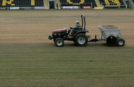 A member of the Burton Albion soccer team groundstaff prepares the pitch at the Pirelli Stadium, Burton-on-Trent, England, Thursday Jan. 5, 2006. Non-league team Burton Albion will take on English soccer giants Manchester United in the 3rd round of the FA Cup this weekend. (AP Photo/Dave Thompson)