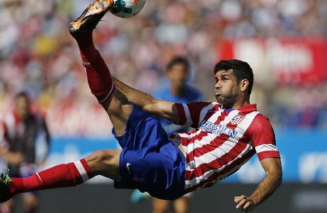 FILE - In this Sept. 14, 2013 file photo, Atletico de Madrid's Diego Costa tries an overhead kick on goal during a Spanish La Liga soccer match against Almeria at the Vicente Calderon stadium in Madrid, Spain. Atletico Madrid and Chelsea said on Thursday Sept. 21, 2017 that they have reached an agreement for the transfer of striker Diego Costa to the Spanish club who will undergo a medical and finalize the contract details with his former club. (AP Photo/Paul White, File)