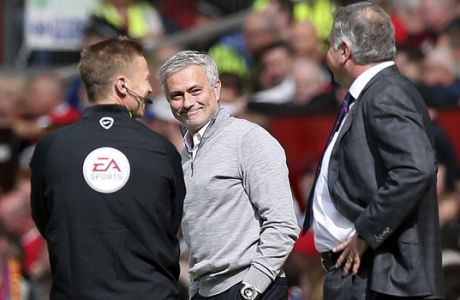 Manchester United manager Jose Mourinho, centre reacts with Crystal Palace manager Sam Allardyce, right, during the English Premier League soccer match between Manchester United and Crystal Palace, at Old Trafford, in Manchester, England, Sunday, May 21, 2017. (Martin Rickett/PA via AP)