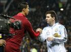 Lionel Messi of Argentina, right, greets Cristiano Ronaldo of Portugal before their International Friendly soccer match at Old Trafford Stadium, Manchester, England, Tuesday Nov. 18, 2014. (AP Photo/Jon Super)