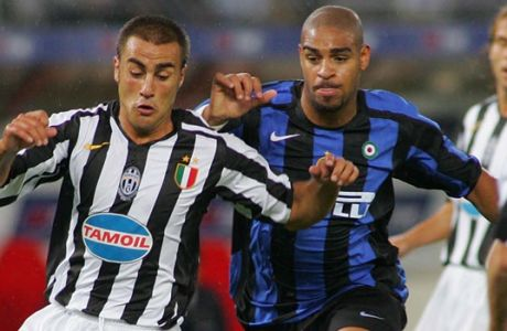 Inter's Adriano of Brazil, right, and Juventus' Fabio Cannavaro in action during their Supercup soccer match between Juventus and Inter at Turin's Delle Alpi Stadium, northern Italy, Saturday, Aug. 20, 2005.(AP Photo/Alberto Ramella)