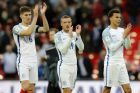 England's John Stones, Jamie Vardy and Dele Alli, from left, clap hands to supporters after winning the World Cup Group F qualifying soccer match between England and Lithuania at the Wembley Stadium in London, Great Britain, Sunday, March 26, 2017. England won the match with 2-0. (AP Photo/Frank Augstein)